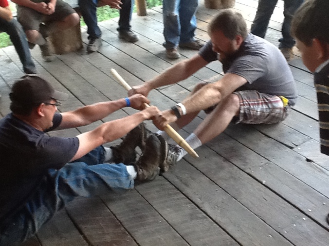 CAMPWIDE GAMES STICK PULLING WITH ADULTS