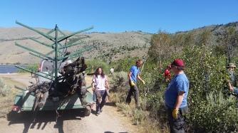 service-staff-loading-poles-on-trailer